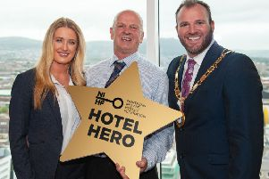 (L-R) Cheryl McCook and NIHF Hotel Hero Davy McMaster from Causeway Hotel with NIHF President Gavin Carroll