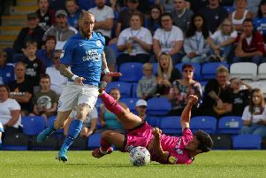 Marcus Maddison in action for Posh against Rochdale.