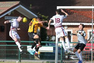 Ben Pope wins a header against Three Bridges on Saturday. Picture by Scott White