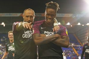 Ivan Toney poses for the camera with Marcus Maddison after his goal at Tranmere. Photo: Joe Dent/theposh.com.