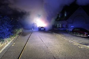 Firefighters tackling the car fire at Ludlow Mews. Photo: Cambridgeshire Fire and Rescue Service