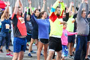 Put your hands in the air if you can't wait for the 2019 Chi Half Marathon / Picture by Derek Martin