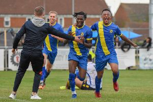 Peterborough Sports pair Maniche Sani (centre) and Dion Sembie-Ferris (right) celebrate the former's goal against Guiseley. Photo: James Richardson.