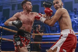 Tyrone McCullagh lands a left hook on his opponent Razaq Najib on his way to a one-sided victory in the quarter-finals of the Golden Contract featherweight event at York Hall last Friday night. Image courtesy of @MTKGlobal)