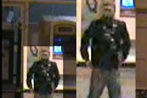 CCTV image of a man police want to trace in connection with the murder