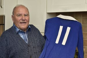 Tommy Robson with his 1973-74 Fourth Division Championship season shirt which he threw into the crowd after beating Gillingham 4-2 and gaining promotion to the Third Division.'It was returned to him anonymously by post last week. EMN-191014-172741009