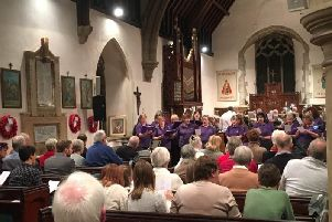 The choir's 2016 Christmas concert. Photo: www.purplepigmusic.com/gallery.