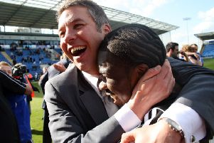 Darren Ferguson celebrates promotion from League One in 2009 with striker Aaron Mclean.