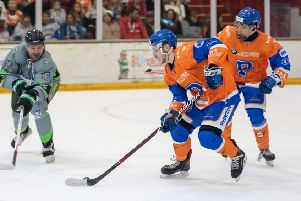 Nathan Long carries the puck out of defence for Phantoms im the home game with Hull. Photo: Tom Scott.