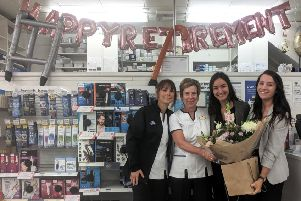 Lin Walpole with colleagues at Boots in Shoreham, where she has worked for 30 years