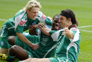 From left, Craig Mackail-Smith, Aaron Mclean and George Boyd will be reunited at Stevenage on Saturday.