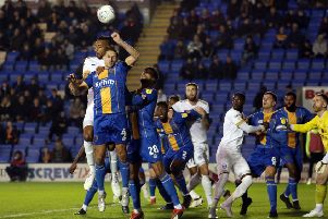 Rhys Bennett of Peterborough United challenges for the ball with David Edwards of Shrewsbury Town. Photo: Joe Dent/theposh.com.