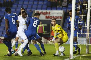 Mohamed Eisa of Peterborough United watches the ball go narrowly wide the Shrewsbury goal. Photo: Joe Dent/theposh.com.