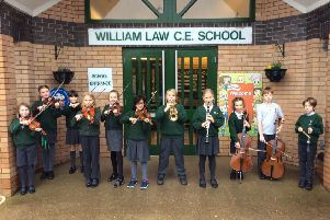 William Law orchestra playing outside the school at the end of the day.