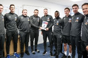 Darren Ferguson with his League One manager-of-the-month award and his Posh management staff. Photo: Joe Dent/theposh.com.