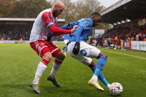Mohamed Eisa of Peterborough United in action with Scott Cuthbert of Stevenage. Photo: Joe Dent/theposh.com.