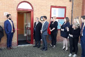 Mayor of Peterborough Gul Nawaz prepares to cut the ribbon to open the new Major Travel office.
