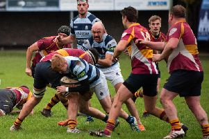 Matt McLagan, supported by Ben Polhill, being tackled / Picture: Chris Hatton