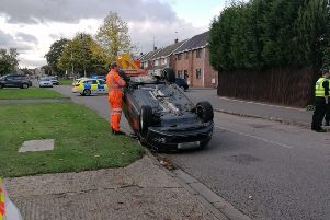 A car on its roof in Ledbury Road