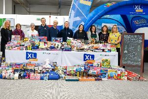 XL Displays' staff with gifts donated last Christmas.