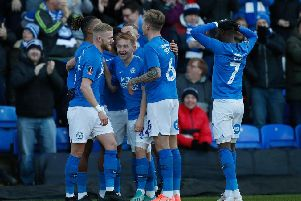 Peterborough United players celebrate Ivan Toney's stunning opening goal