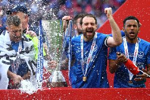Nathan Thompson (right) celebrates winning the EFL Trophy with Portsmouth in March