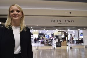 John Lewis and Partners' operations manager Tracy Venner outside the store with its new branding.