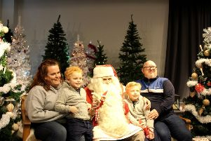 Mum Rebecca, little brother Cody, Caleb and dad Kurt pay Santa a visit in Lapland