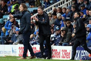 Rival managers Gareth Ainsworth and Darren Ferguson.