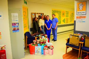 Staff with the donations