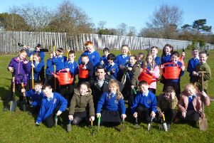 Pupils at St Francis' PS ready to get gardening at their new allotment