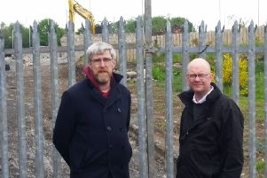 Sinn Fein MLA John O'Dowd with party colleague Cllr Paul Duffy