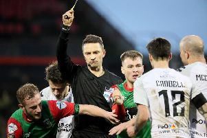 Referee Andris Treimanis sent three players off during the game.  Photo by David Maginnis/Pacemaker Press