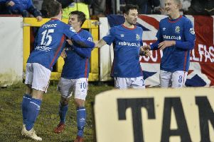 Jordan Stewart and his Linfield team-mates celebrate a late goal against Portadown. Pic by INPHO.