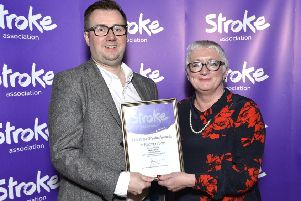 Will McLean receiving certificate of nomination from Stroke Association committee Member Anne Gamble.