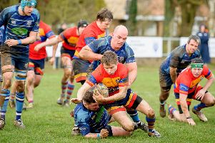 Patrick Northover's break from the back of the scrum is brought to an end. Pictures: Mike Baker