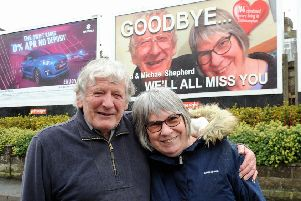 Tan and Michael Shepherd in front of the billboard dedicated to them. Picture: Kate Shemilt ks190080-1