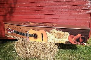 A country and western themed coffin