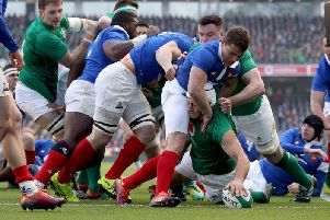 Ireland captain Rory Best goes over to score the opening try after two minutes against France.