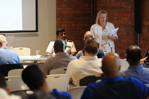 PCC Kathryn Holloway discusses Community Hub numbers at a public meeting in Linslade last year