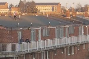 Youngsters on the roof of flats in Lurgan's Russell Drive