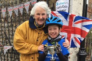 Callum Smith with his grandmother Sue Harris at the finish line in Angmering