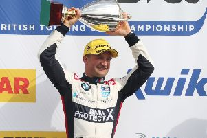 Colin Turkington celebrates one of his two wins at Donington Park