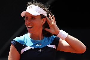 MADRID, SPAIN - MAY 07:  Johanna Konta of Great Britain reacts against Simona Halep of Romania during day four of the Mutua Madrid Open at La Caja Magica on May 07, 2019 in Madrid, Spain. (Photo by Julian Finney/Getty Images) SUS-190514-112527002