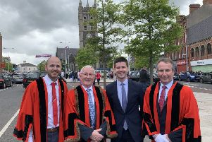 Upper Bann MLA Jonathan Buckley with three DUP councillors in Portadown on Sunday