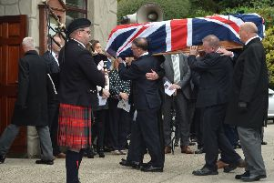 The coffin of Willie Frazer is carried into Five Mile Hill Pentecostal church at Mountnorris in south Armagh on Monday. He died in hospital on Friday from organ failure after repeated battles with cancer. He lost five close relatives during the Troubles, including his father Bertie, who was murdered by the IRA in 1975.' Photo: Colm Lenaghan/Pacemaker