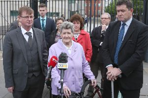 Willie Frazer, Beatrice Worton and her son Colin Worton outside  the opening of the Kingsmills Massacre inquest in May 2016. Photo: Matt Mackey / Press Eye