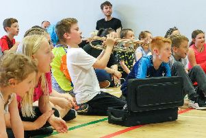 """Young people enjoy the """"Showcase afternoon"""" at Goal Line with a bit of music thrown in to support those up performing."""