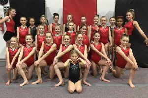 A group of young gymnasts from The Academy of Gym