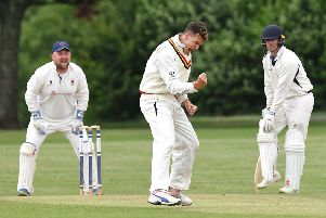 Archie Reynolds celebrates a wicket with James Scutt, left. Picture: Neil Marshall (180616_020)